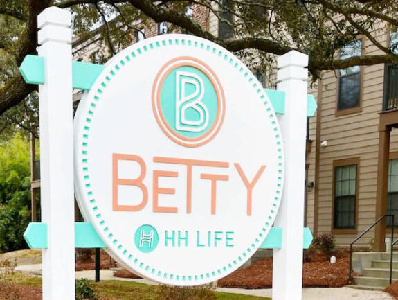 The Betty entrance banner with The Betty logo and contact information