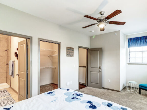 Master bedroom view with spacious closet, bathroom and window.